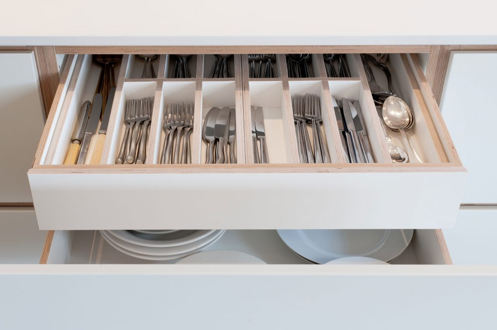 Don't forget to think about hidden drawers and internal mechanisms when you're planning your kitchen design.
