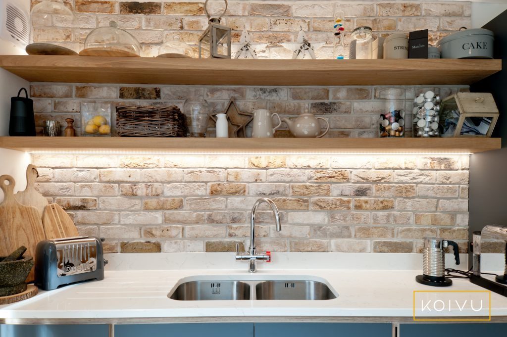 We'll support you with planning your kitchen design layout. Open shelving works well over exposed stonework to add interest.