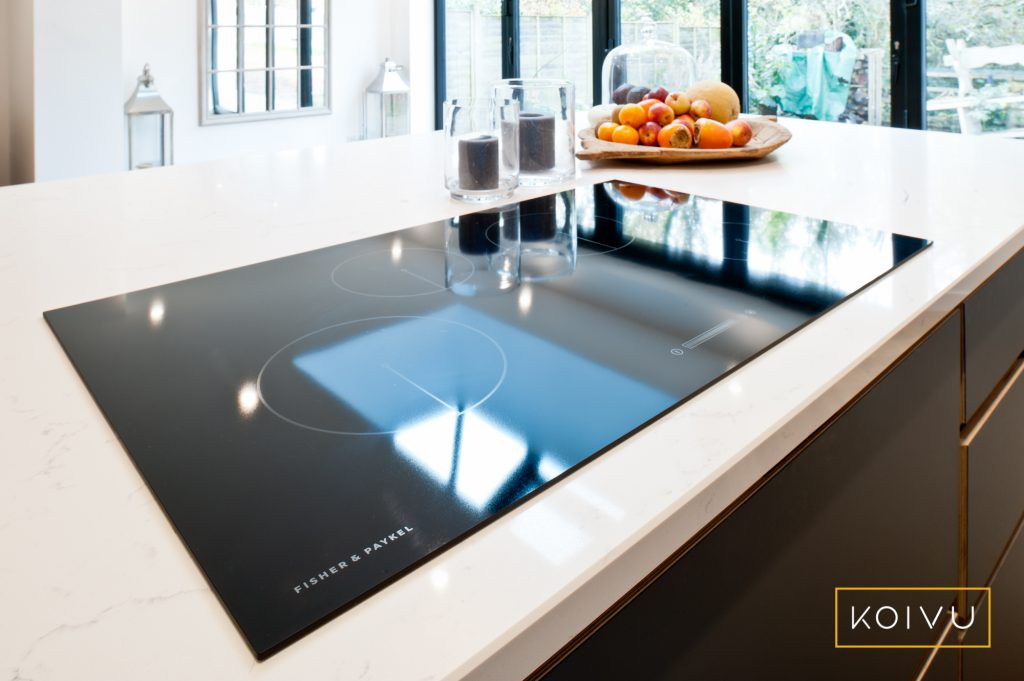 A large induction hob sunk into a white worktop.