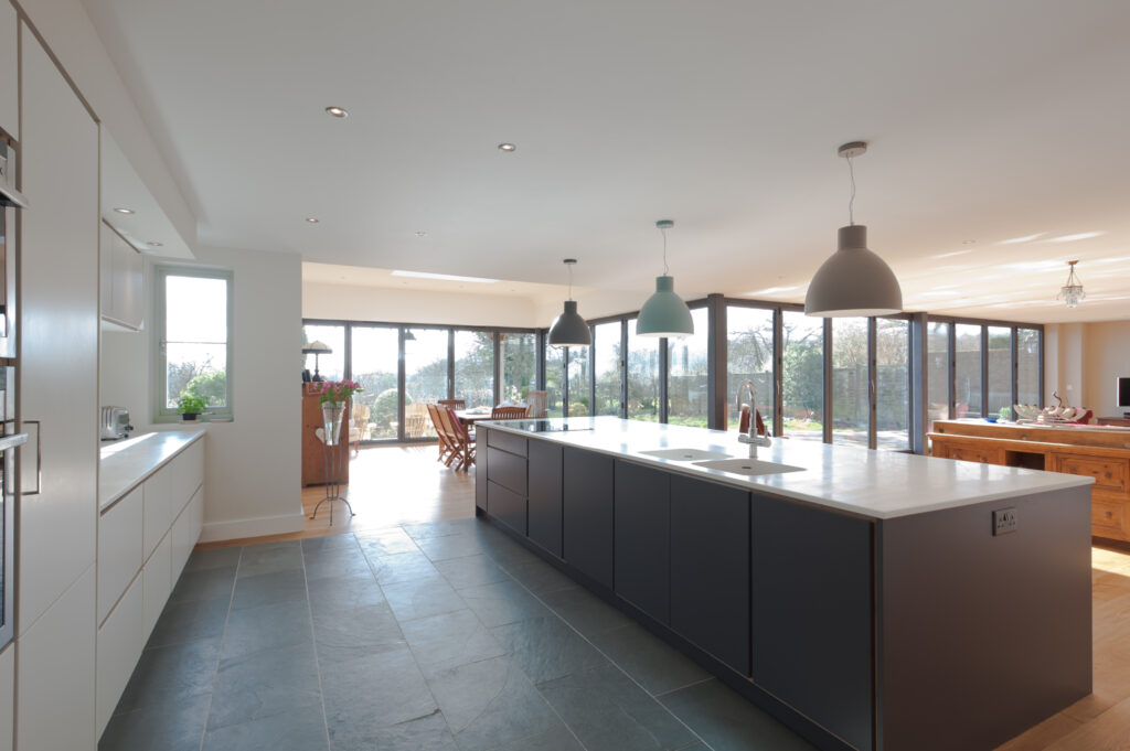 Plywood kitchen with a huge view of the garden