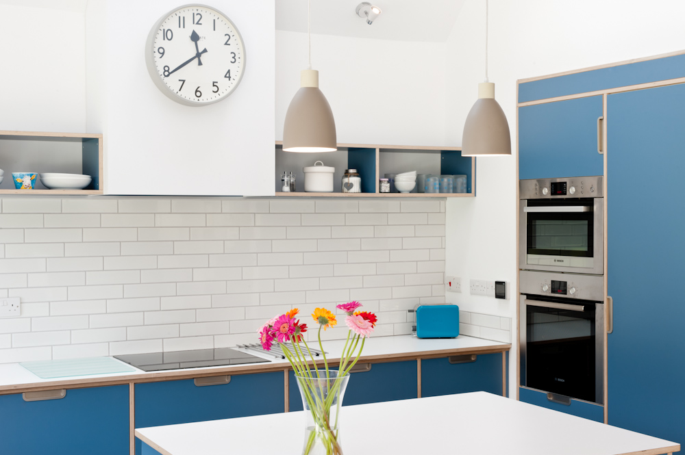 Birch plywood kitchen in blue ovens and hob
