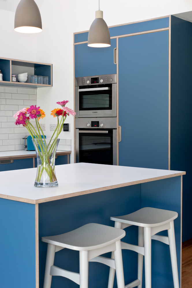 Plywood kitchen blue tall units and isalnd