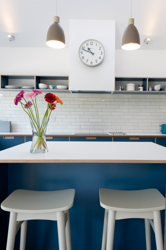 Blue plywood kitchen view from island stools