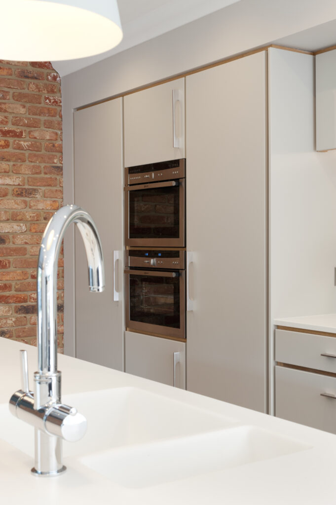 Plywood kitchen sink in island, oven housing and fridges