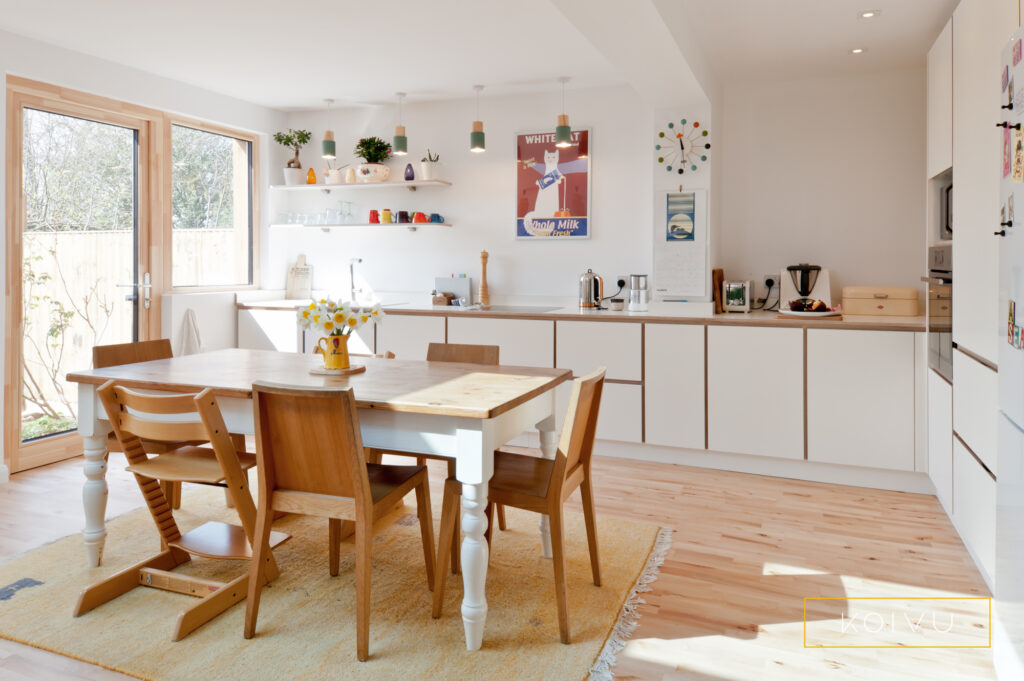 Plywood kitchen in white with view to the garden