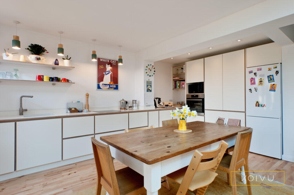 L-shape plywood kitchen in white with wooden floor