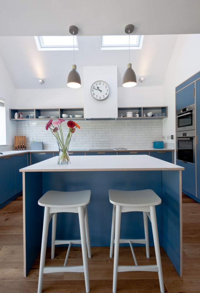 Plywood kitchen blue formica with view of sky lights
