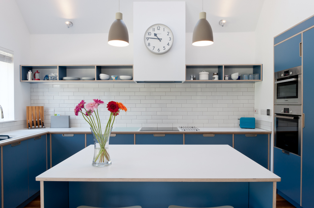 Plywood kitchen in blue with oven housing