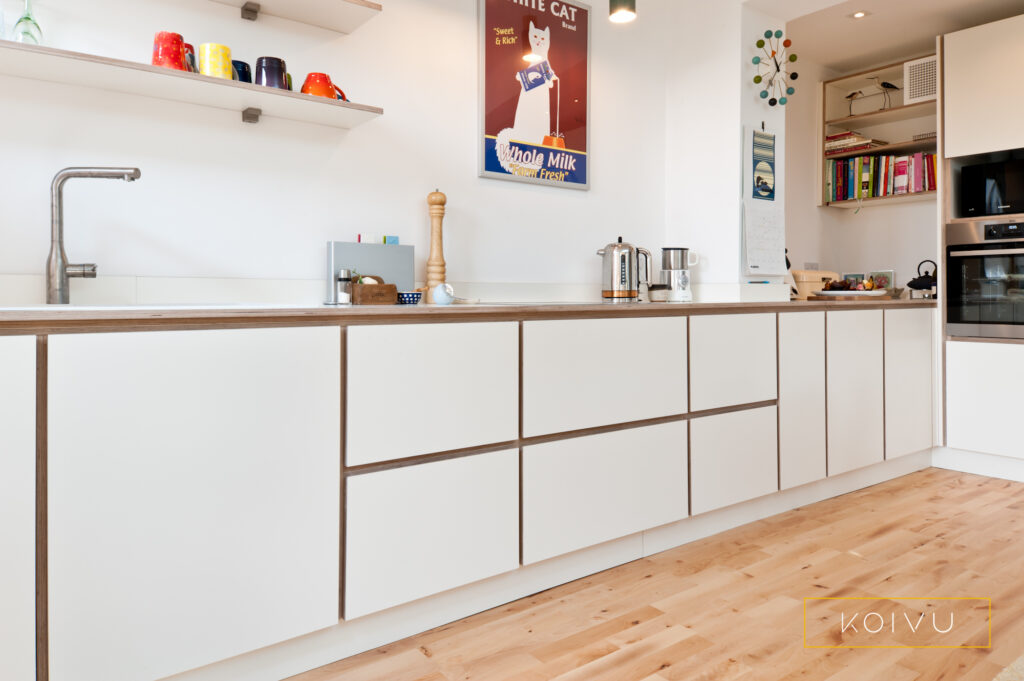 Plywood kitchen with white drawers