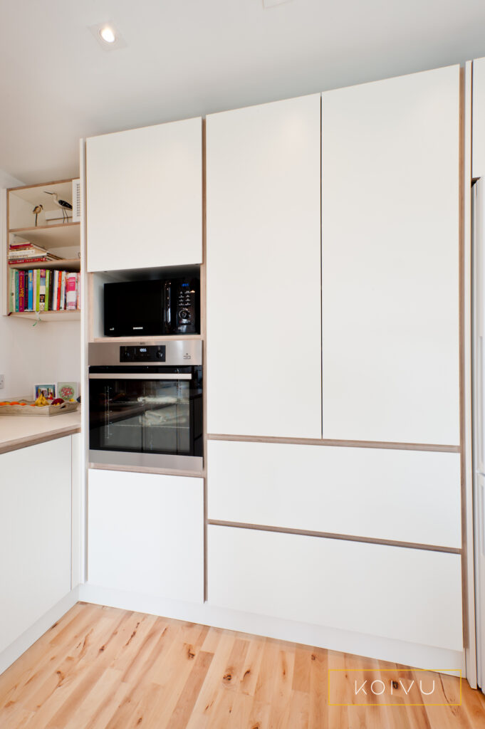 White plywood kitchen larder and oven housing