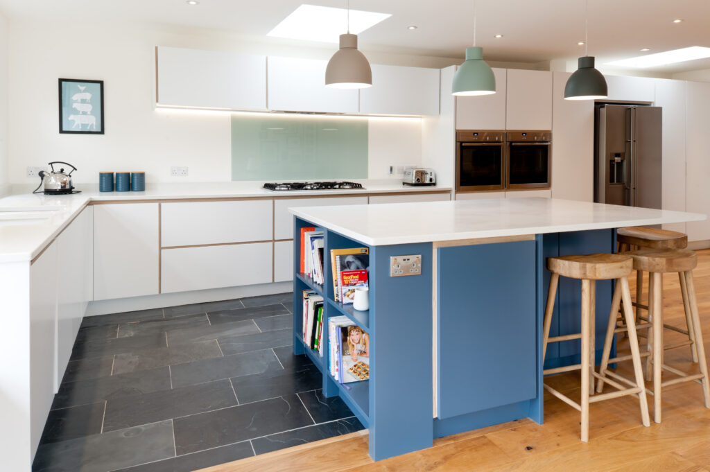 L-shape plywood kitchen in white with blue island