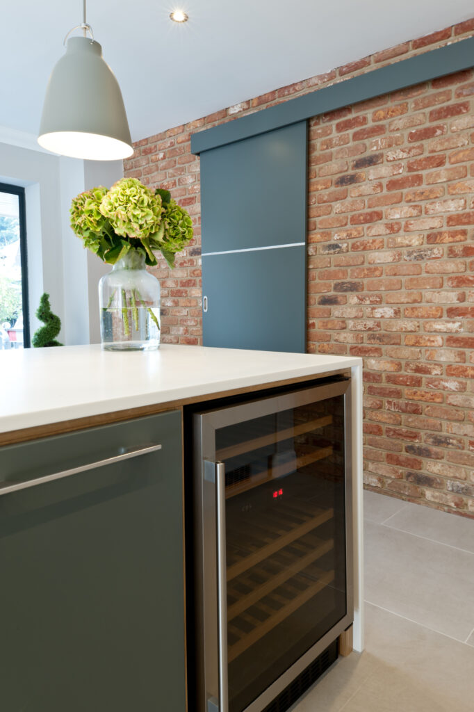 Plywood kitchen with wine cooler in island