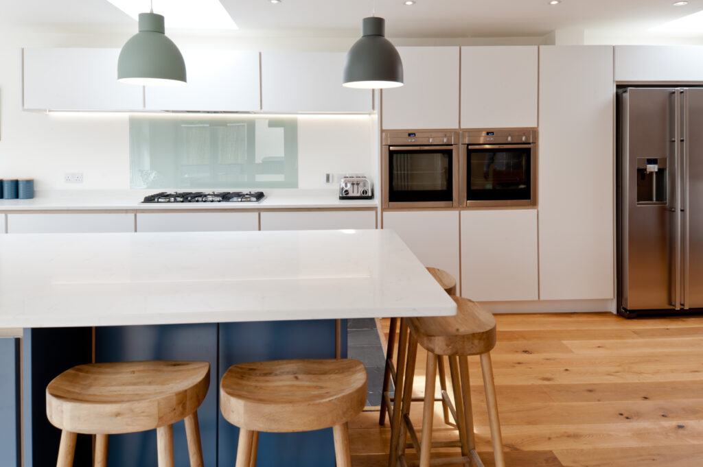 A plywood kitchen in white and blue