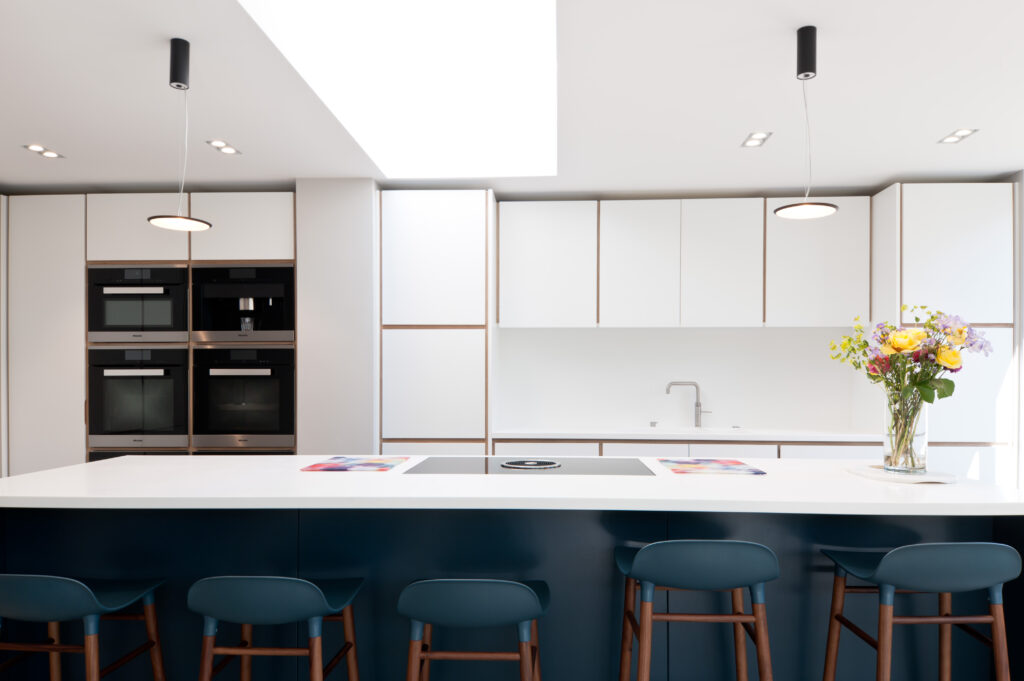 Family kitchen with large blue island and white units