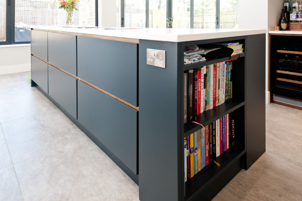Open shelving in an island with large pan drawers