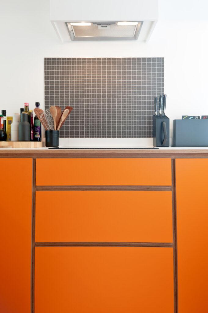 Hob with drawers under in orange kitchen