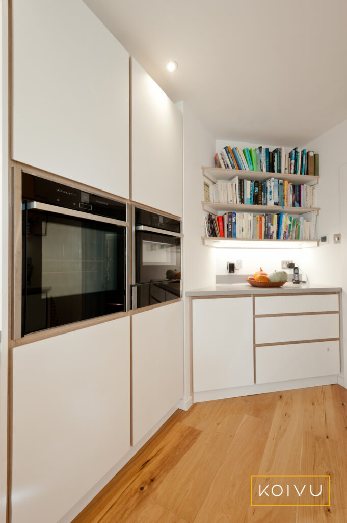 Koivu Plywood kitchen with double ovens