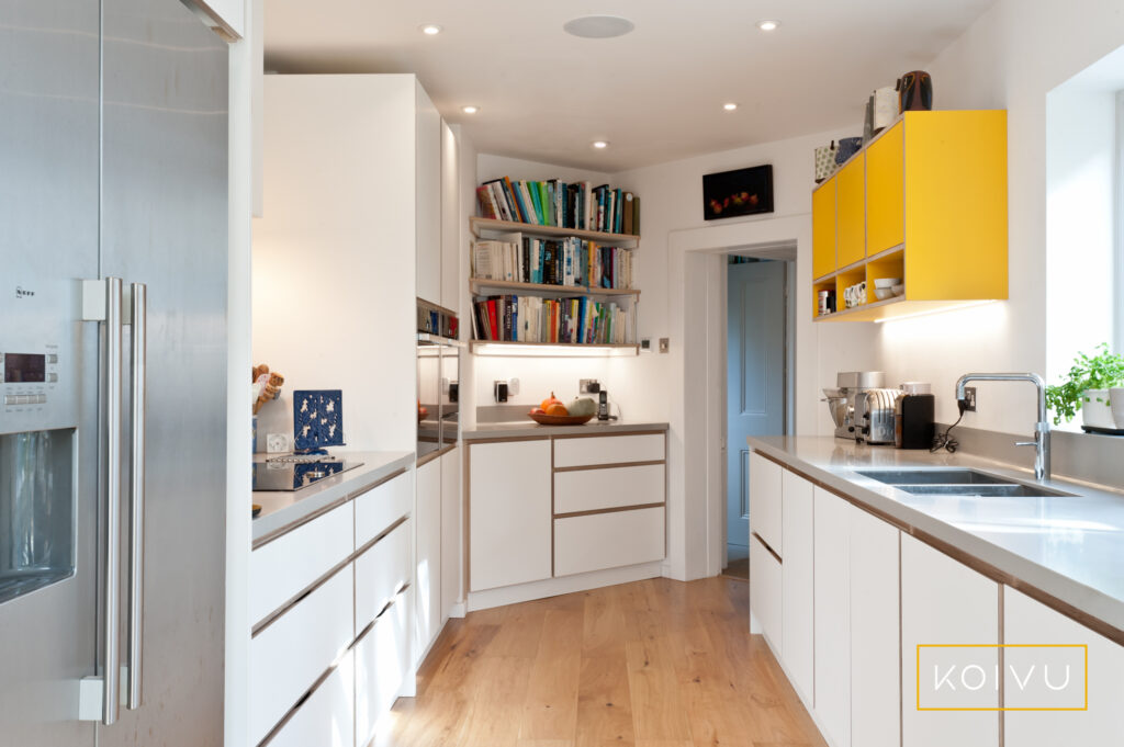 White plywood kitchen with yellow wall units