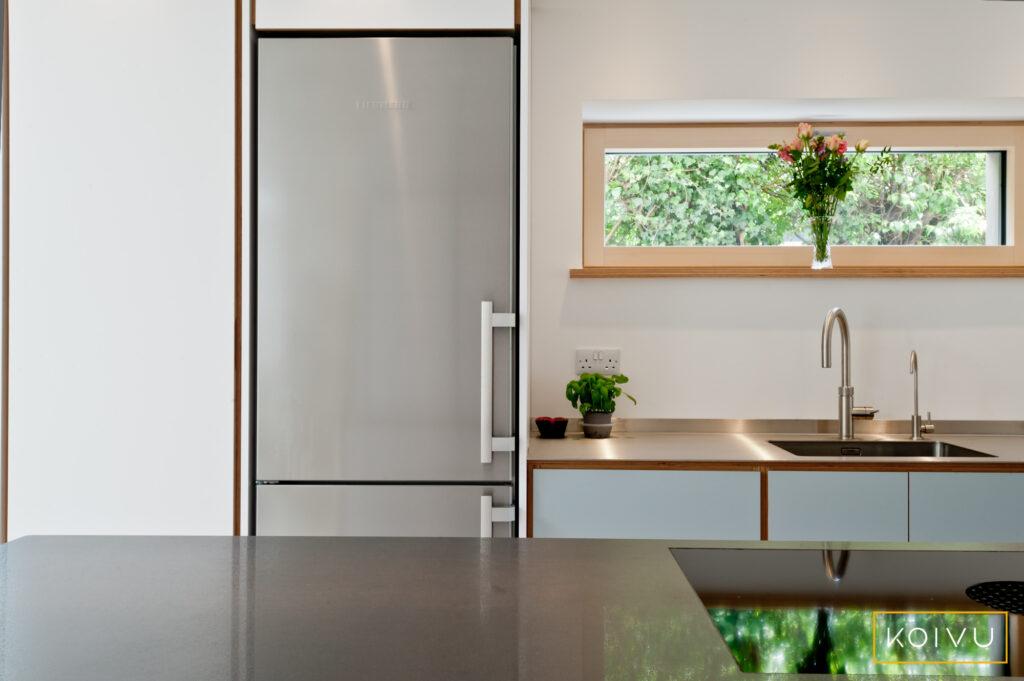 Freestanding fridge freezer built into kitchen run