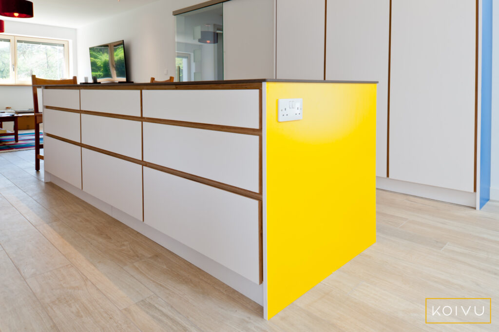 Drawer units in white island with yellow end panel