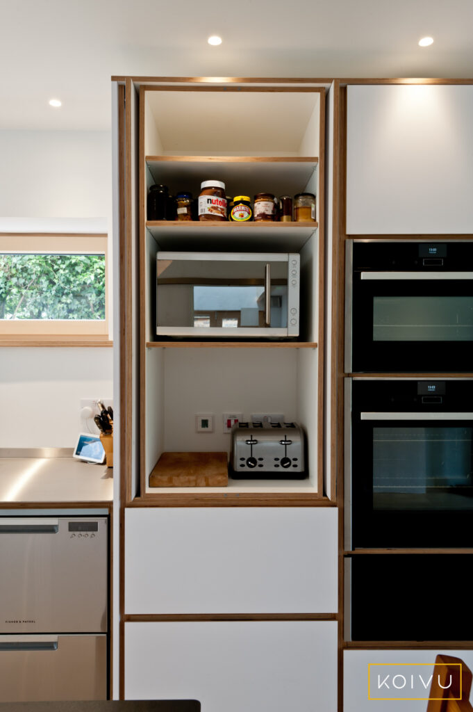 Open butler's cupboard in a white plywood kitchen