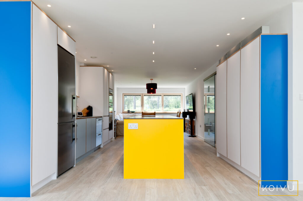 White kitchen with island in the middle