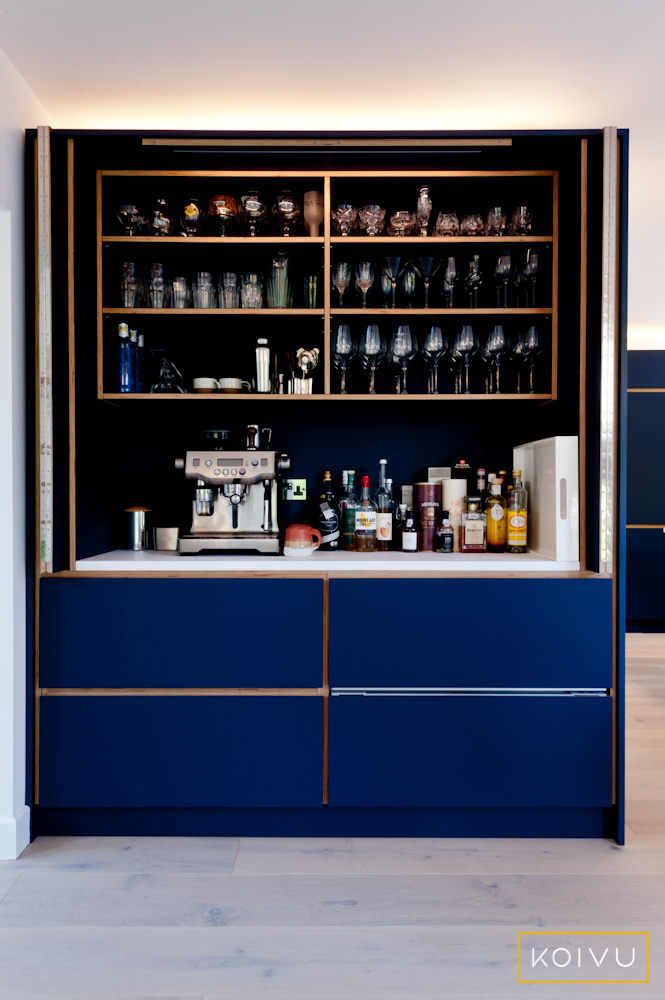 A unique butler cupboard incorporated into a bespoke Koivu kitchen design.